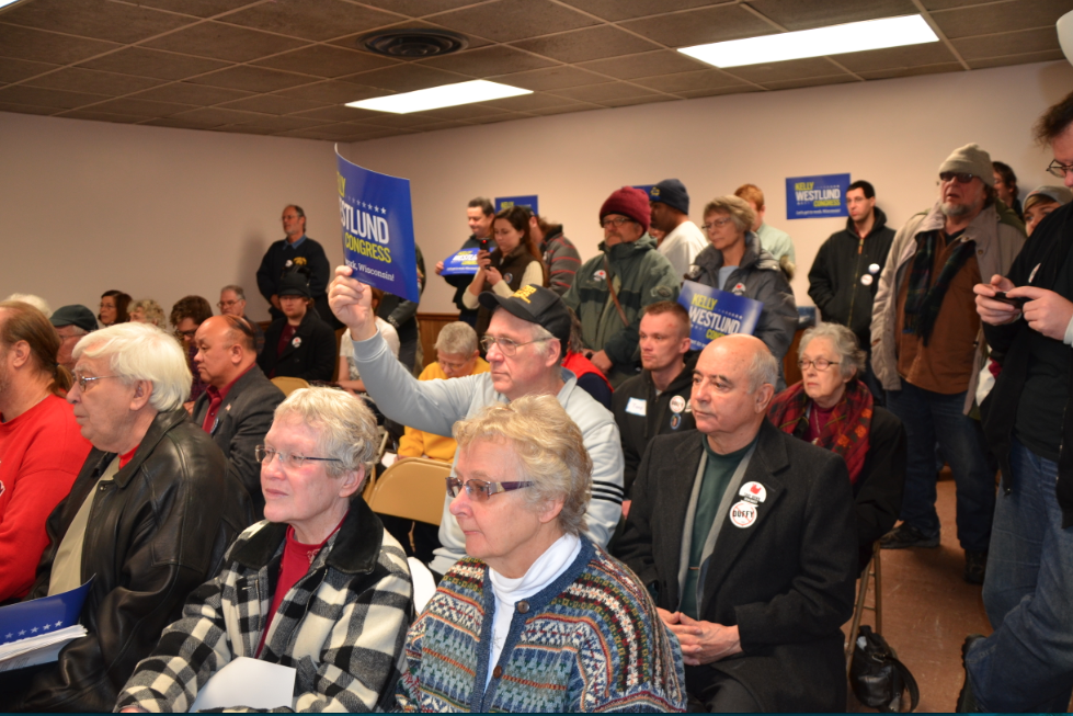 Wisconsin voters listen intently as Kelly talks about the issues that matter to Wisconsin voters